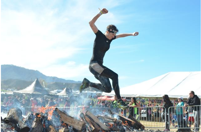 Jane  Woodman has competed in multiple Spartan races, in which competititors run up mountains, climb over walls, crawl under barbed wire and jump over fire.