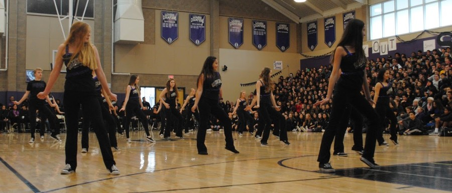 Sequoia+dance+team+performs+at+the+Winter+rally+in+Gym+1+with+the+sport+banners+shown+in+the+background.
