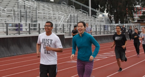 Seniors JC Lara and Emma O'Hara run together at track and field practice, a coed sport, Thursday, March 2.
