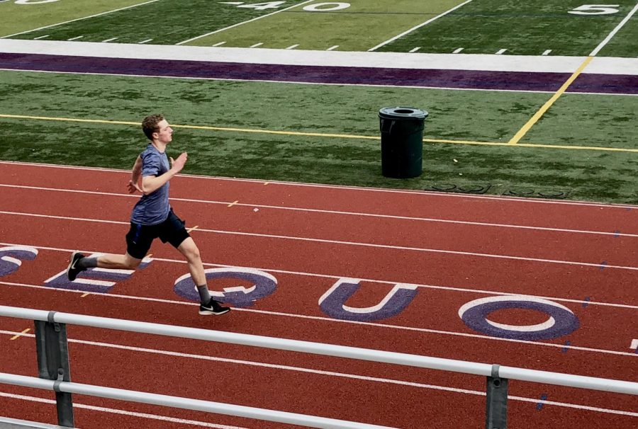 Junior, John Horan running in track. Running with passion is helpful for miles, though many teens lack determination.
